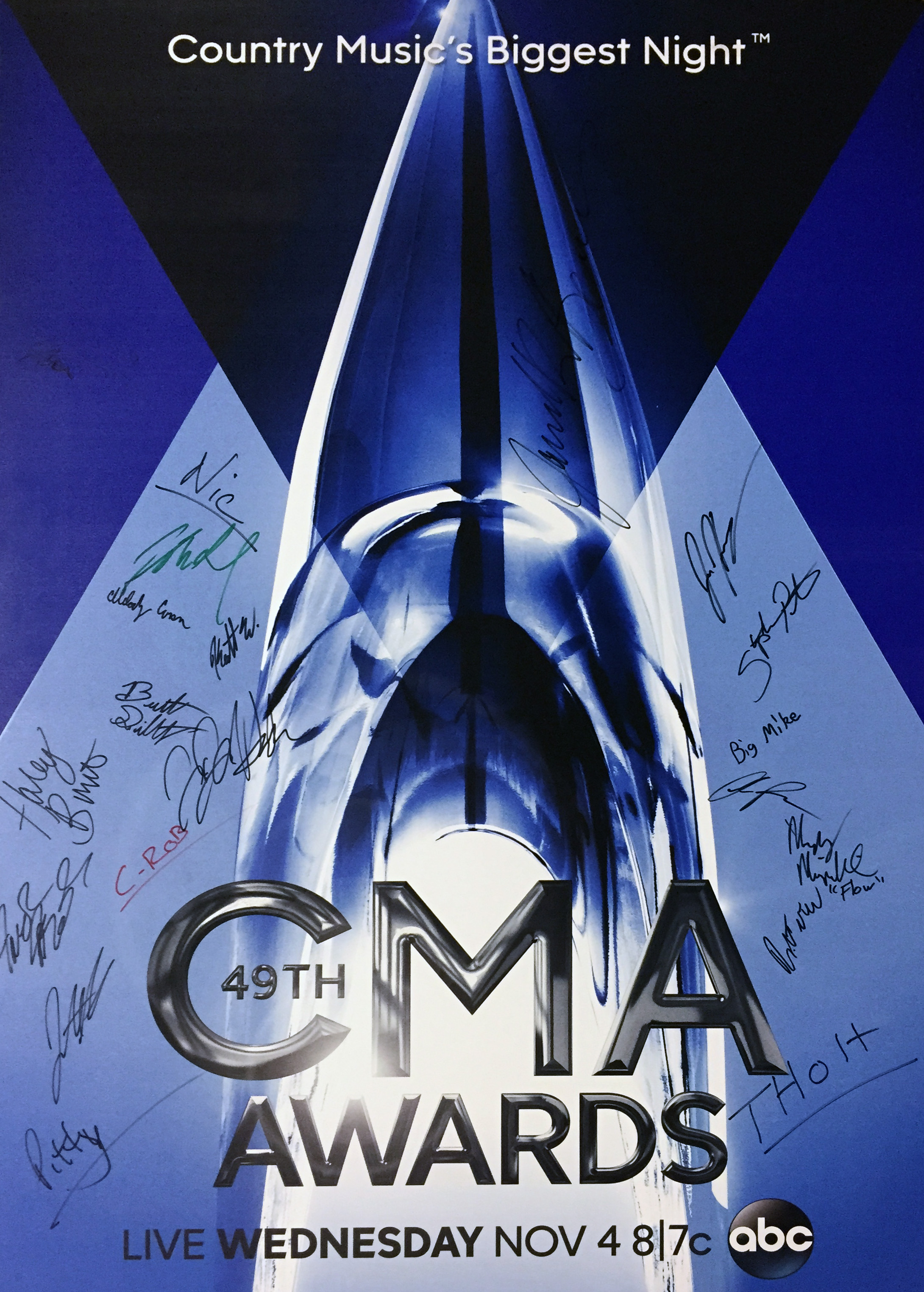 CMA poster signed by MTSU alumni and current students working the television production of the event. Photo courtesy of Nic Dugger.